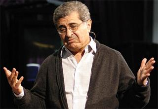 "Terry Semel doing the classic ""palms-out"" pose"