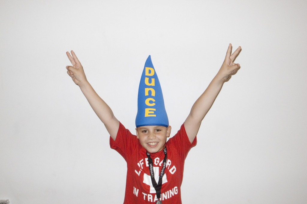 Why is this gentile child being humiliated by wearing a dunce cap?