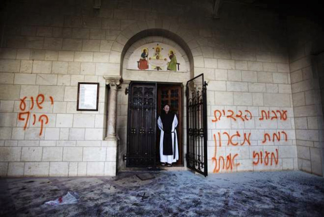 """Jesus is a monkey"" once again spray painted on the wall.  The door to the monastery was set ablaze."